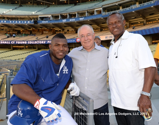 Yasiel Puig poses with Manny Mota and guest prior to the game. Jill Weisleder/LA Dodgers