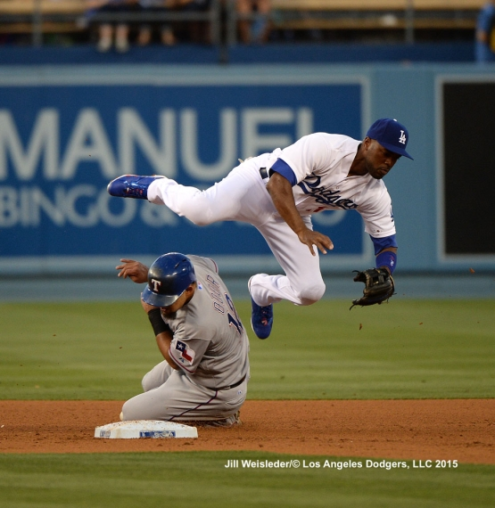 Jimmy Rollins goes over the head of Rougned Odor at second base. Jill Weisleder/LA Dodgers