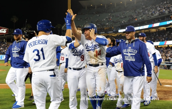 Joc Pederson high-fives Enrique Hernandez on a walk-off balk in the ninth inning. Jill Weisleder/LA Dodgers