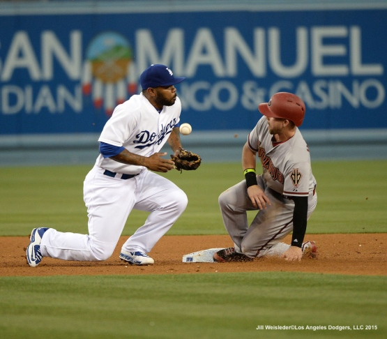 Howie Kendrick attempts to make the catch at second but falls short. Jill Weisleder/LA Dodgers