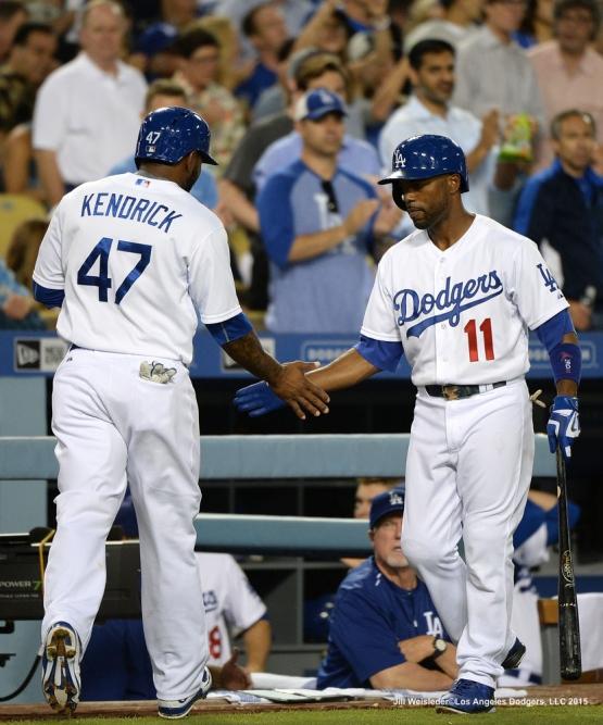 Jimmy Rollins celebrates with Howie Kendrick after scoring in a run. Jill Weisleder/LA Dodgers