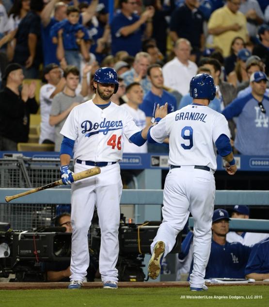Pitcher Mike Bolsinger congratulates Yasmani Grandal after scoring in a run. Jill Weisleder/LA Dodgers