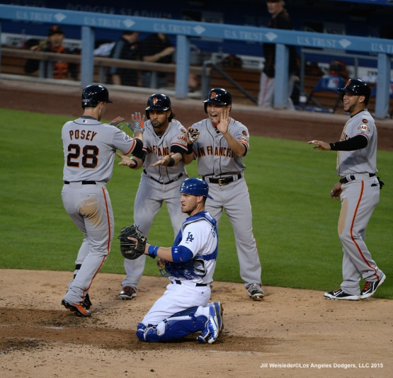 Yasmani Grandal reacts as Buster Posey crosses home plate after getting a grand slam. Jill Weisleder/LA Dodgers