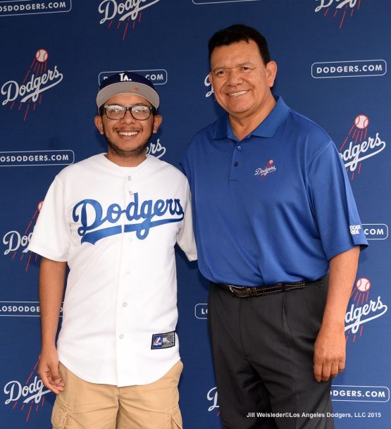 Fernando Valenzuela poses for a photo with a fan during Viva Los Dodgers. Jill Weisleder/Dodgers