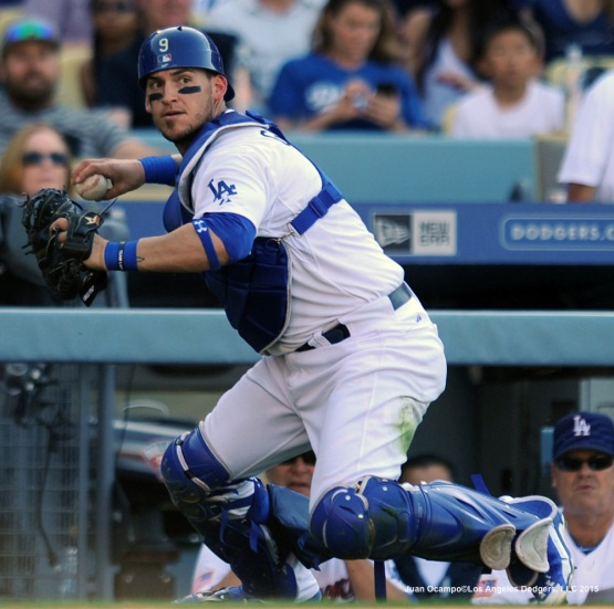 Yasmani Grandal looks to first base after fielding a wild pitch in the fifth inning.