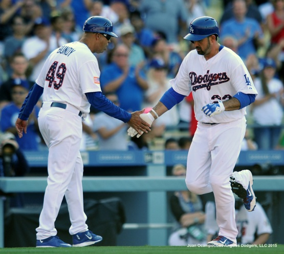Adrian Gonzalez is congratulated by third-base coach Lorenzo Bundy after his home run in the fifth inning.