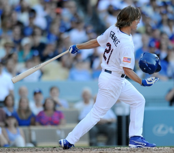 Zack Greinke catches his helmet during his at bat in the fifth inning.