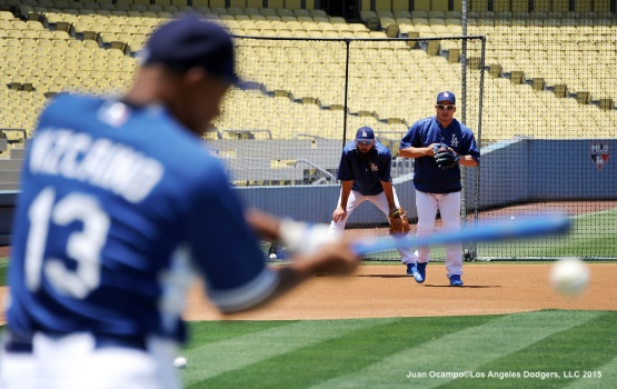 Jose Vizcaino, Alex Guerrero and Scott Van Slyke take part in infield practice before the game against the New York Mets.