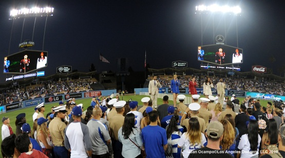 The USO Show Troupe performs during the post game 4th of July festivities.