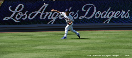 Starter Zack Greinke warms up in left field before the game against the Mets.
