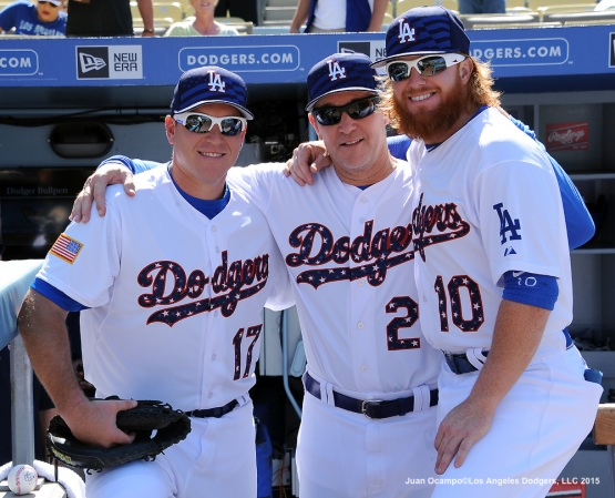 A.J. Ellis, Tim Wallach and Justin Turner pose for a photo.