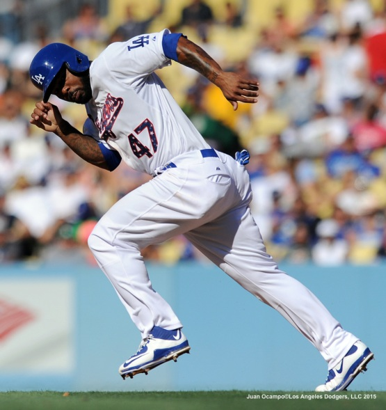 Howie Kendrick heads towards second base on a steal attempt in the third inning.