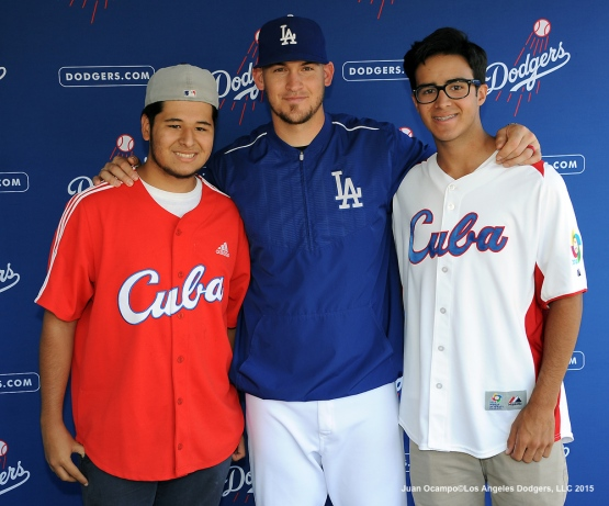 Yasmani Grandal poses for a photo with fans during Cuban Heritage Day at Viva Los Dodgers at Dodger Stadium.