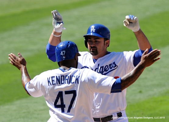 Adrian Gonzalez is congratulated by Howie Kendrick after Gonzalez's two-run homer in the eighth inning.