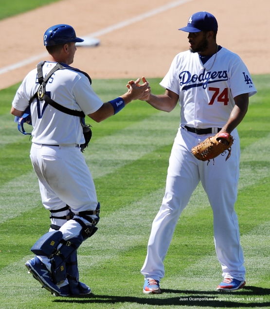 A.J. Ellis and Kenley Jansen congratulate each other after the Dodgers' 4-3 victory over the Brewers.