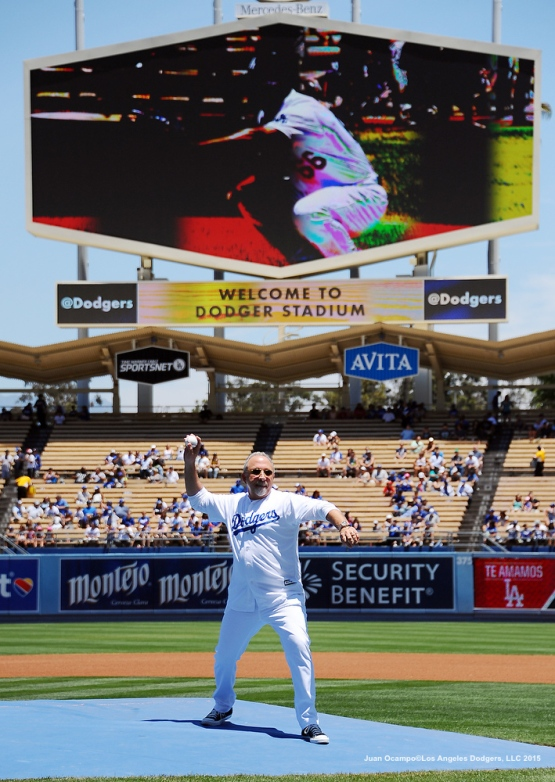 Cuban music legend Emilio Estefan throws out the ceremonial first pitch before the game against the Brewers.