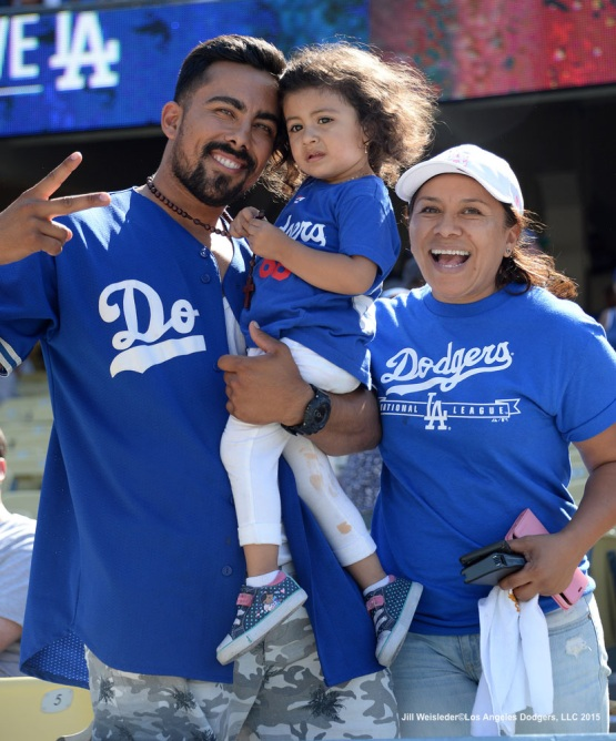 Dodger fans pose for a photo after the 8-0 loss against the New York Mets. Jill Weisleder/Dodgers