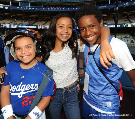 Dodger fans pose for a photo on the field prior to the game. Jill Weisleder/LA Dodgers