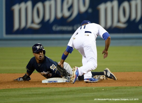 Jimmy Rollins applies the tag to Jean Segura. Jill Weisleder/LA Dodgers