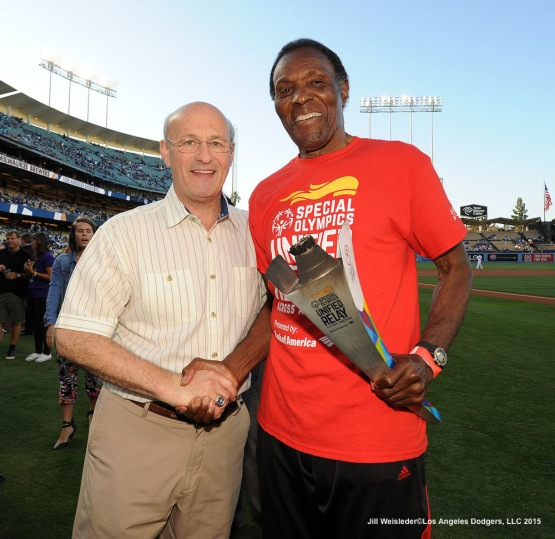 Dodger President and CEO Stan Kasten and former decathlete and Olympic gold medalist Rafer Johnson pose for a photo during pre game festivities. Jill Weisleder/LA Dodgers