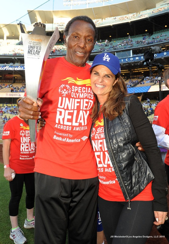 Rafer Johnson and Maria Shriver participate during the pre game festivities prior to the game. Jill Weisleder/LA Dodgers