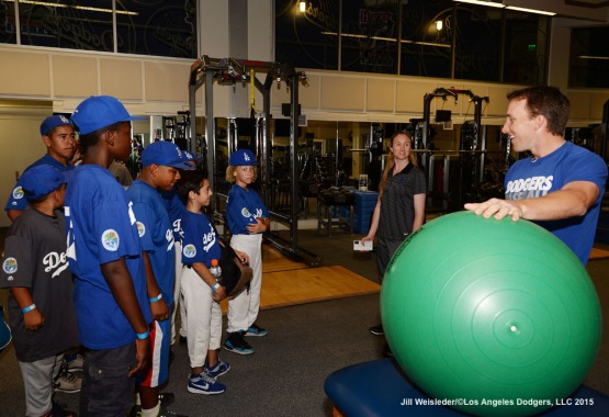 Participants get a tour of the Dodgers weight room during the clinic. Jill Weisleder/LA Dodgers