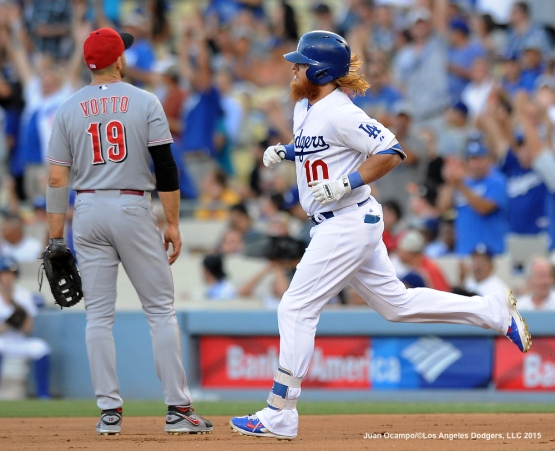 Justin Turner rounds first base after hitting a home run in the third inning.