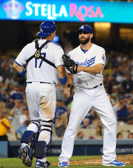 A.J. Ellis and Chris Hatcher congratulate each other after the Dodgers' 8-3 victory over the Reds.