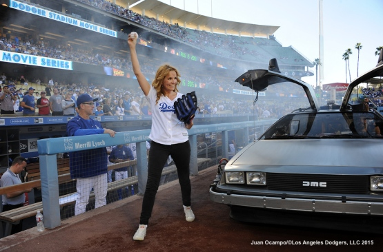 "Actress Lea Thompson makes her way to the field with the help of the DeLorean Time Machine from the movie ""Back To The Future""."
