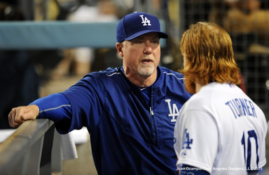 Dodgers hitting coach Mark McGwire talks with Justin Turner.