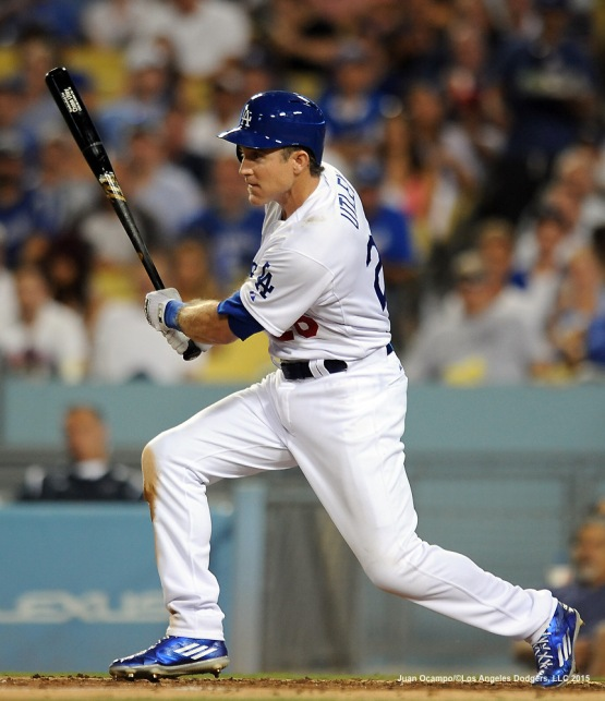 Chase Utley hits a triple in the third inning.