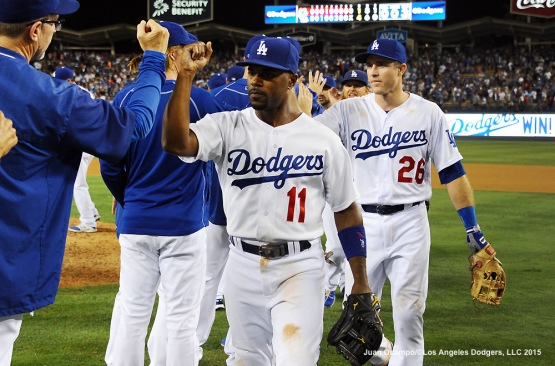 Jimmy Rollins and Chase Utley celebrate the Dodgers' 4-1 win over the Chicago Cubs.