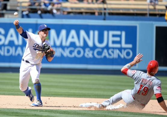 Kike Hernandez throws out Joey Votto at second base. Jill Weisleder/LA Dodgers