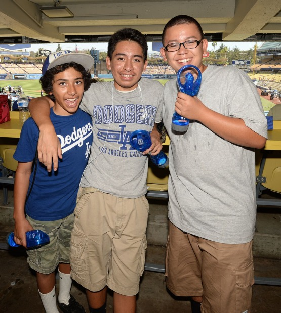 Fans try to stay cool during the game with Dodger spray bottles which were given out to people attending today's game at Dodger Stadium. Jill Weisleder/LA Dodgers