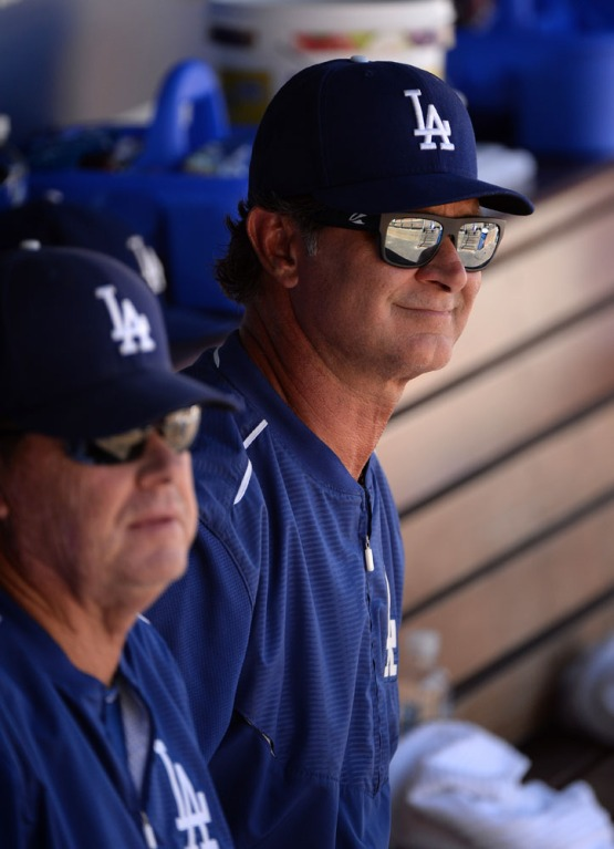 Ricky Honeycutt and Don Mattingly in the dugout. Jill Weisleder/LA Dodgers