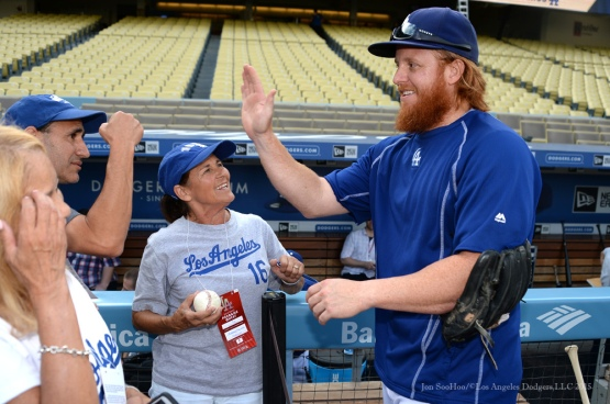 Justin Turner high fives with fans Tuesday, September 15,2015 at Dodger Stadium in Los Angeles, California. Photo by Jon SooHoo/ ©Los Angeles Dodgers,LLC 2015