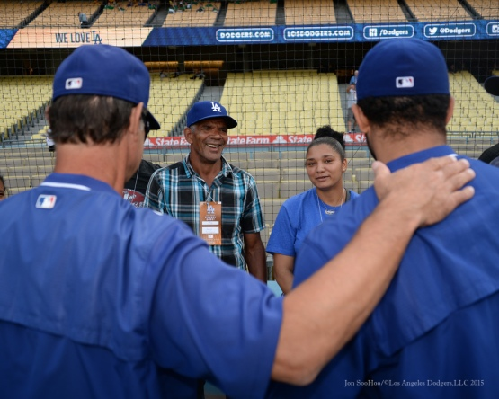 Don Mattingly is introduced to the Yimi Garcia family prior to game-Los Angeles Dodgers vs Colorado Rockies Tuesday, September 15,2015 at Dodger Stadium in Los Angeles, California. Photo by Jon SooHoo/ ©Los Angeles Dodgers,LLC 2015