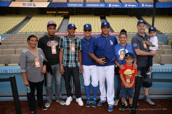 Don Mattingly poses with Yimi Garcia and family---Los Angeles Dodgers vs Colorado Rockies Tuesday, September 15,2015 at Dodger Stadium in Los Angeles, California. Photo by Jon SooHoo/ ©Los Angeles Dodgers,LLC 2015