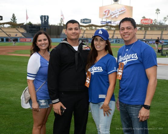 """Military Hero of the Game"" United States Navy Equipment Operator First Class, Peter Izarra and family prior to Los Angeles Dodgers vs Colorado Rockies Tuesday, September 15,2015 at Dodger Stadium in Los Angeles, California. Photo by Jon SooHoo/ ©Los Angeles Dodgers,LLC 2015"