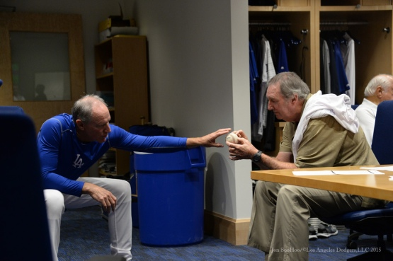 Former Dodger knuckleball pitcher Charlie Hough shows coach Ron Roenicke his grip prior to game Tuesday, September 15,2015 at Dodger Stadium in Los Angeles, California. Photo by Jon SooHoo/ ©Los Angeles Dodgers,LLC 2015