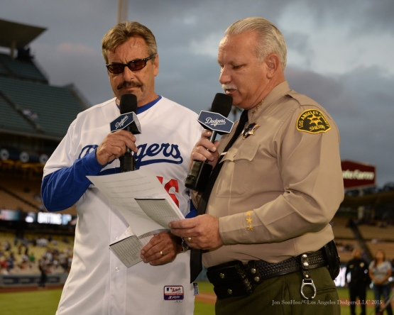 LAPD Police Chief Charlie Beck and LA County Assistant Sheriff, Mike Rothan read the Dodgers starting line up--Los Angeles Dodgers vs Colorado Rockies Tuesday, September 15,2015 at Dodger Stadium in Los Angeles, California. Photo by Jon SooHoo/ ©Los Angeles Dodgers,LLC 2015
