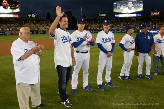 Eric Karros waves to the crowd during ceremony honoring Los Angeles Dodgers Captain John Shoemaker----Los Angeles Dodgers vs Colorado Rockies game Tuesday, September 15,2015 at Dodger Stadium in Los Angeles, California. Photo by Jon SooHoo/ ©Los Angeles Dodgers,LLC 2015