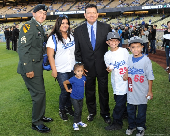 Fernando Valenzuela poses with Military Hero of the Game United States Army Staff Sergeant, Edgar Valles and family--Los Angeles Dodgers vs Colorado Rockies Wednesday, September 16, 2015 at Dodger Stadium in Los Angeles, California. Photo by Jon SooHoo/ ©Los Angeles Dodgers,LLC 2015