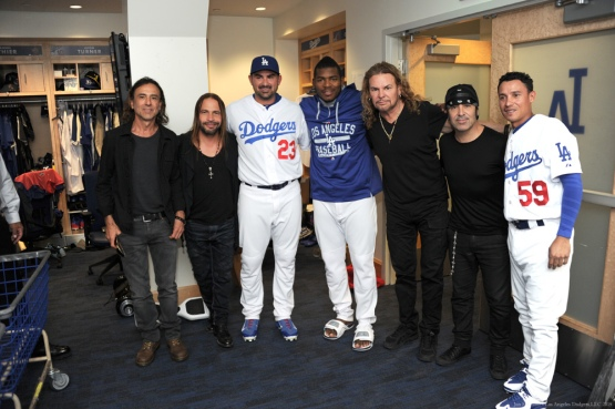 Adrian Gonzalez, Yasiel Puig and Ronald Torreyes pose with Mana--Los Angeles Dodgers vs Colorado Rockies Wednesday, September 16, 2015 at Dodger Stadium in Los Angeles, California. Photo by Jon SooHoo/ ©Los Angeles Dodgers,LLC 2015