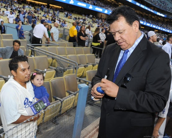 Fernando Valenzuela signs for fans--Los Angeles Dodgers vs Colorado Rockies Wednesday, September 16, 2015 at Dodger Stadium in Los Angeles, California. Photo by Jon SooHoo/ ©Los Angeles Dodgers,LLC 2015