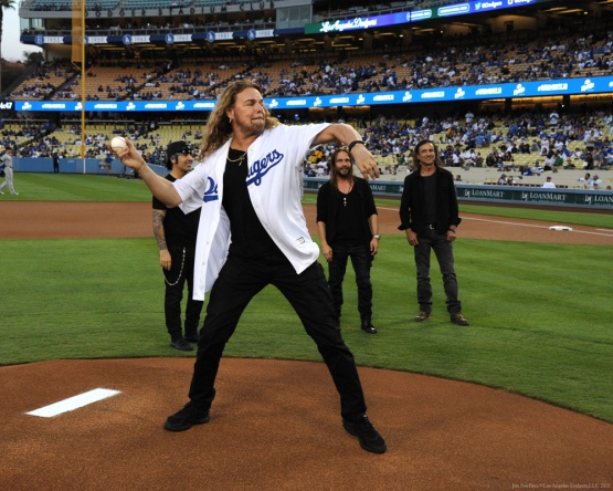 Fher Olvera, of Mana throws out the first pitch Wednesday, September 16, 2015 at Dodger Stadium in Los Angeles, California. Photo by Jon SooHoo/ ©Los Angeles Dodgers,LLC 2015