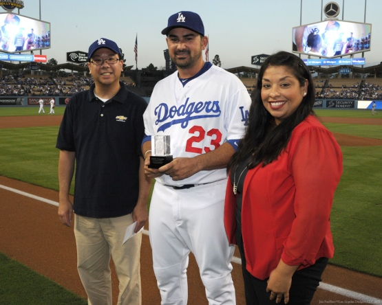 Adrian Gonzalez receives the Roberto Clemente Award from Felix Wu, of Chevrolet and Elvia Barboa, CEO of Padres Contra el Cancer--Los Angeles Dodgers vs Colorado Rockies Wednesday, September 16, 2015 at Dodger Stadium in Los Angeles, California. Photo by Jon SooHoo/ ©Los Angeles Dodgers,LLC 2015