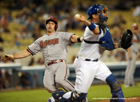 The Diamondbacks' Paul Goldschmidt is forced out at home by A.J. Ellis.