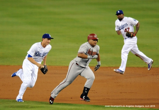 Corey Seager runs down the Diamondbacks' Yasmany Tomas for the out.