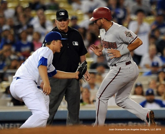 Corey Seager gets ready to tag out the Diamondbacks' David Peralta attempting to steal third base.